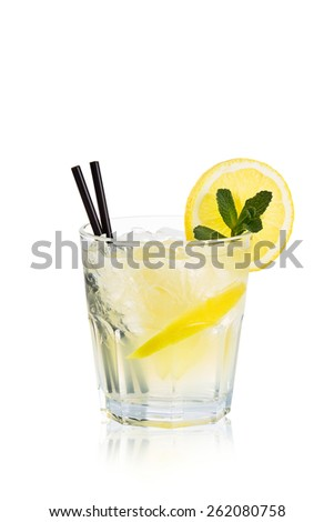 Transparent refreshing cocktail in a glass with lemon and mint