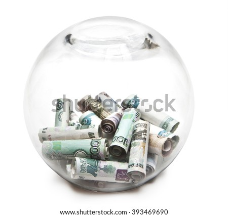 Transparent round piggy Bank with the Russian money - stock photo