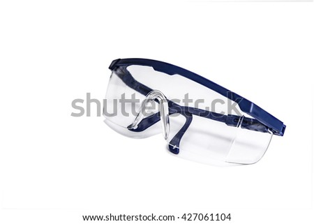 transparent safety goggles with blue frames for power tool operation to prevent harmful splashes of particle in industrial or medical operation - stock photo
