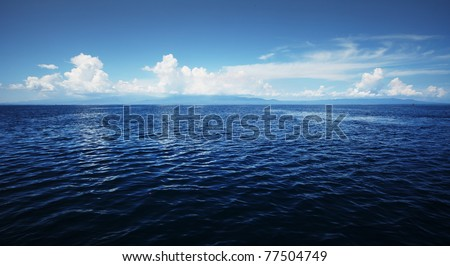 Transparent sea and white clouds. Area near Bunaken island. indonesia - stock photo