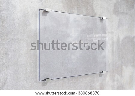 Transparent signboard on concrete wall, mock up - stock photo