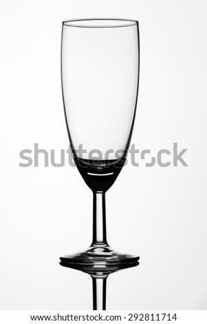 Transparent wine glass on isolated white background - stock photo