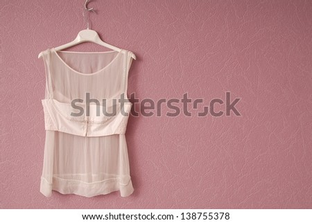 Transperent blouse is on lilac background. - stock photo