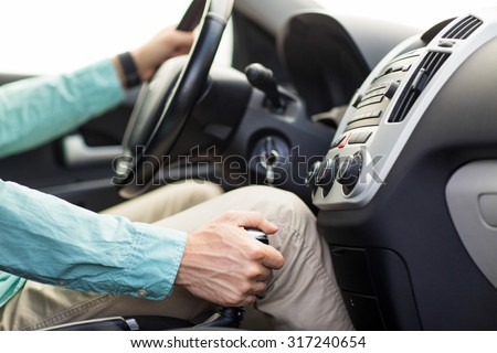 transport, business trip, speed, destination and people concept - close up of young man driving car - stock photo