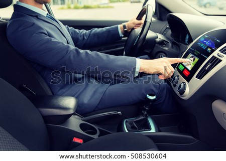 transport, business trip, technology and people concept - close up of young man in suit driving car and receiving incoming call from woman on board computer screen