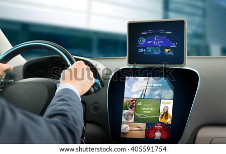 transport, business trip, technology, navigation and people concept - close up of young man with gps navigator on tablet pc and on-board computer menu driving car - stock photo