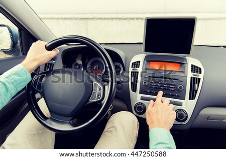 transport, business trip, technology, navigation and people concept -close up of young man with tablet pc computer driving car - stock photo