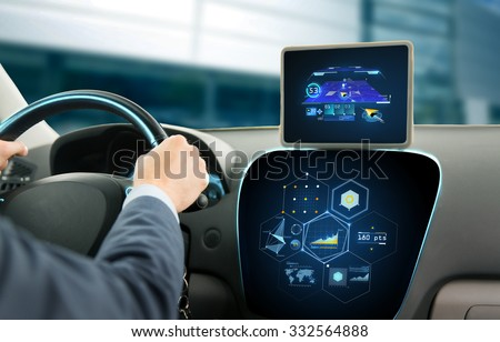 transport, destination, modern technology and people concept - close up of man driving car with navigation system on tablet pc computer and charts - stock photo