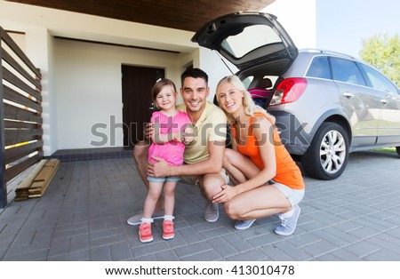 transport, leisure, road trip and people concept - happy family with little girl and hatchback car at home parking space