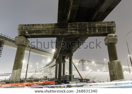 transport metropolis, traffic and blurry lights of cars on multi-lane highways and  road junction at night in Moscow - stock photo