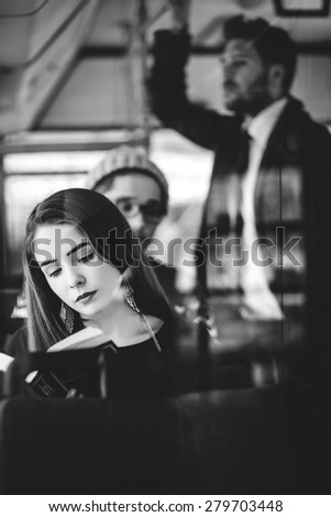 transport. people in the bus. she wondered in transport. - stock photo
