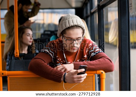 transport. people in the bus. she wondered in transport. man rides a bus, listening to music - stock photo