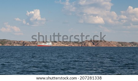 Transport ship on swedish coast - stock photo