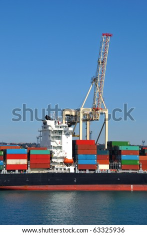 Transport ship unloading/loading - stock photo