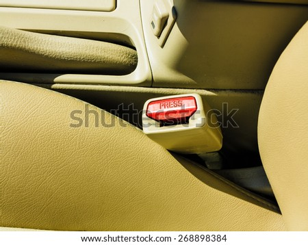 Transportation and safety concept. interior modern car elements, close-up of seat belt.