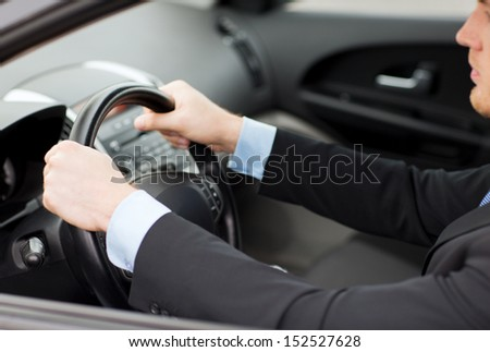 transportation and vehicle concept - businessman driving a car