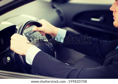 transportation and vehicle concept - businessman driving a car - stock photo