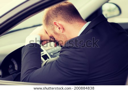 transportation and vehicle concept - tired businessman or taxi car driver - stock photo
