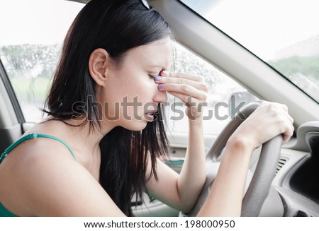 Transportation concept - tired woman driver. - stock photo