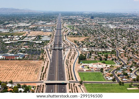 Transportation corridor in the east valley, the Superstition Freeway, U.S. Route 60 viewed from above looking west from Mesa towards Tempe and Phoenix - stock photo