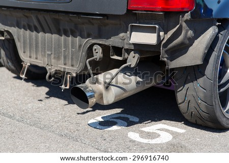 transportation, freight transport and vehicle parts concept - close up of truck exhaust pipe - stock photo
