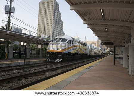 Transportation hub facility/Orlando Transit Center/Buses and trains leaving for morning commute . - stock photo