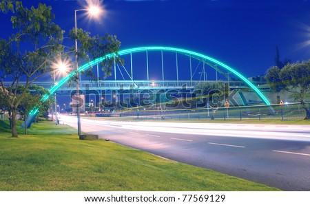 transportation long exposure with modern bridge night scene - stock photo