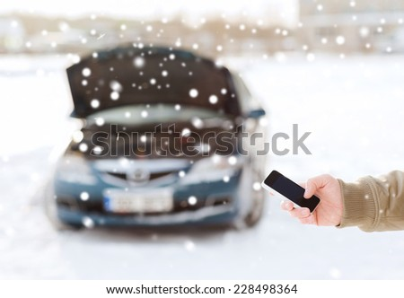 transportation, winter, people and vehicle concept - closeup of man with broken car and cell phone - stock photo
