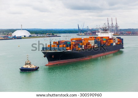 transporter ship sailing from dock in southhampton - stock photo