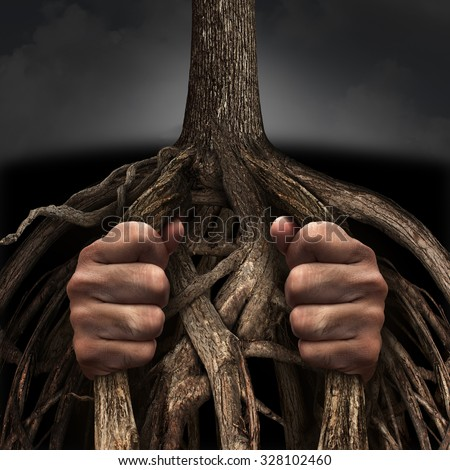Trapped concept and mental prison symbol as a person caged and imprisoned by the slow growing tree roots as a metaphor for chronic ingrained suffering due to an addiction or psychological illness. - stock photo