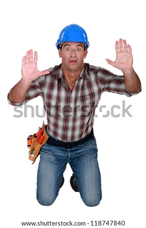 Trapped construction worker - stock photo
