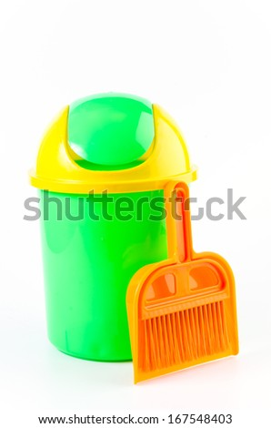 Trash and broom on isolated white background
