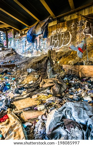 Trash and graffiti under the Howard Street Bridge in Baltimore, Maryland.