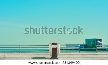 Trash bin on Baku boulevard near the blue sea - stock photo
