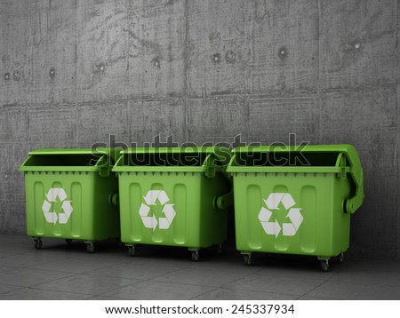 Trash can dustbins outside concrete wall. - stock photo