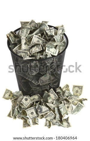 Trash can full of dollar bills - stock photo