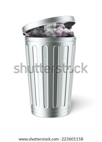 Trash can full of euro bills  - stock photo