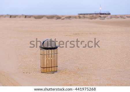 trash can on the beach sunny day. concept photo of a clean beach - stock photo