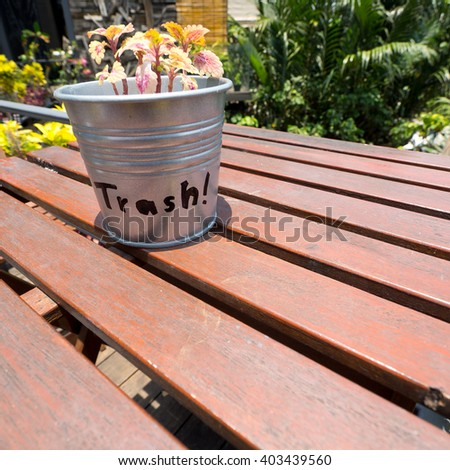 Trash Can On The Clean Wooden Table