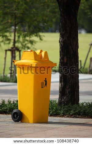 trash can yellow in park - stock photo