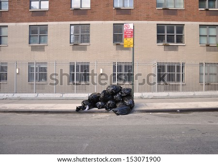 Trash Curbside No Parking Sign New York - stock photo