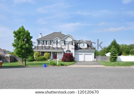 Trash Recycle Day Suburban McMansion Single Family House Residential Neighborhood - stock photo