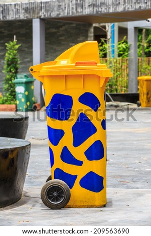 Trash yellow polka dots pattern in the park. - stock photo