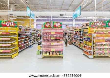 Trat, Thailand - January 22, 2016: Aisle view of a Tesco Lotus supermarket on January 22, 2016. Tesco is the world's second largest retailer with 6,531 stores worldwide. - stock photo