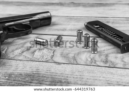 stock-photo-traumatic-pistol-with-bullet