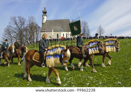 TRAUNSTEIN, GERMANY - APRIL 9: biggest annual catholic horse procession at easter, named - Osterritt - Georgiritt - in bavarian city Traunstein with 400 horses at April 9, 2012 in Traunstein, Germany - stock photo