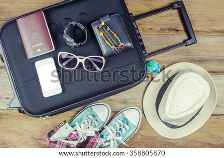 Travel accessories costumes. Passports, luggage, sunglasses The cost of travel maps prepared for the trip