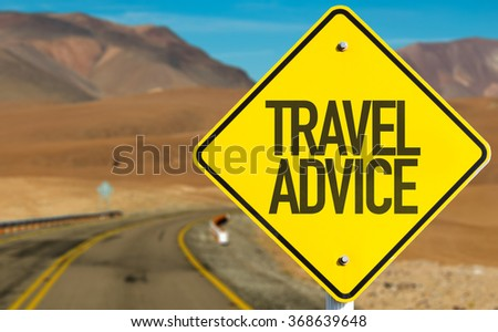 Travel Advice sign on desert road - stock photo