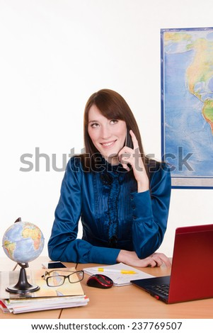 Travel agency manager talking on the phone