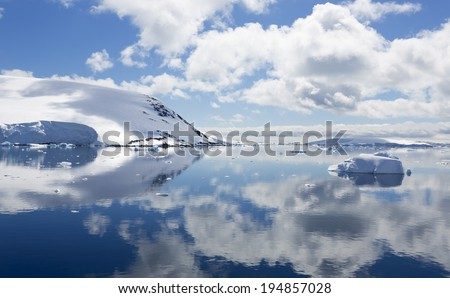 Travel among ices of Antarctic. Glaciers and icebergs of unusual forms. Studying of a phenomenon of global warming. - stock photo